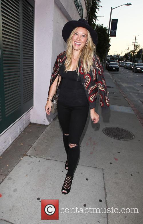 Hilary Duff walking heads for a restaurant on...