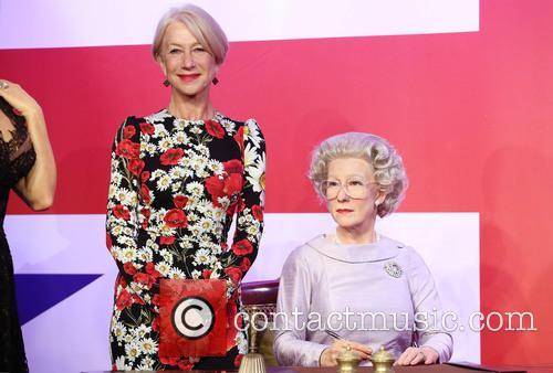 Dame Helen Mirren views her three wax figures