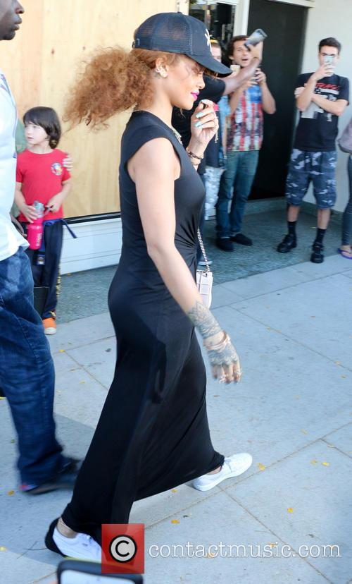 Rihanna was spotted leaving mac store in Beverly...