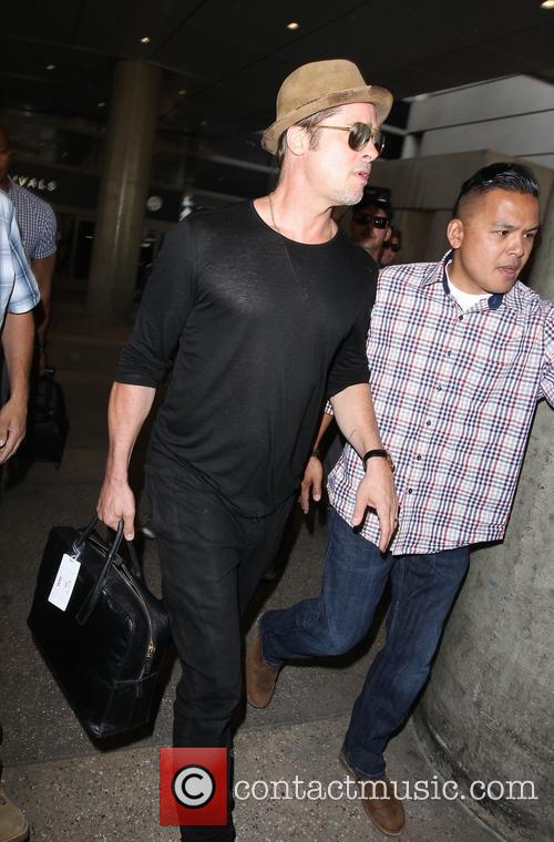 Brad Pitt arrives at Los Angeles International Airport...