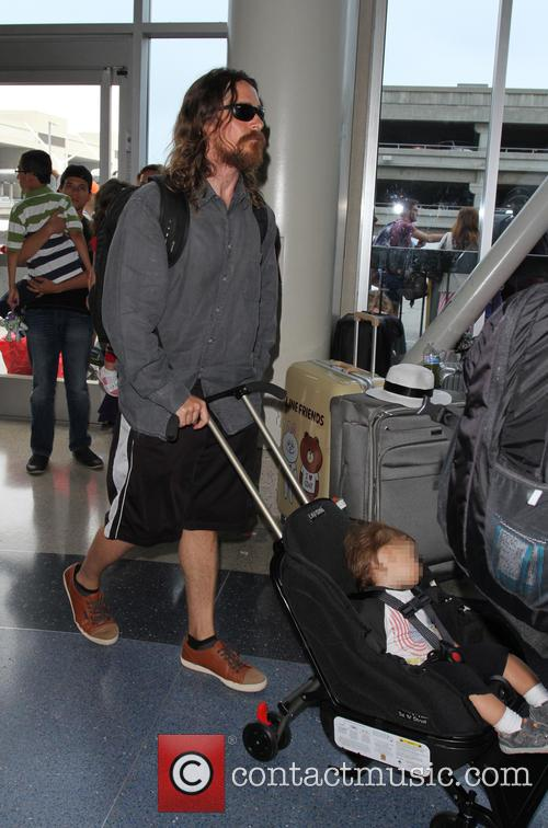 Christian Bale arrives at Los Angeles International Airport...