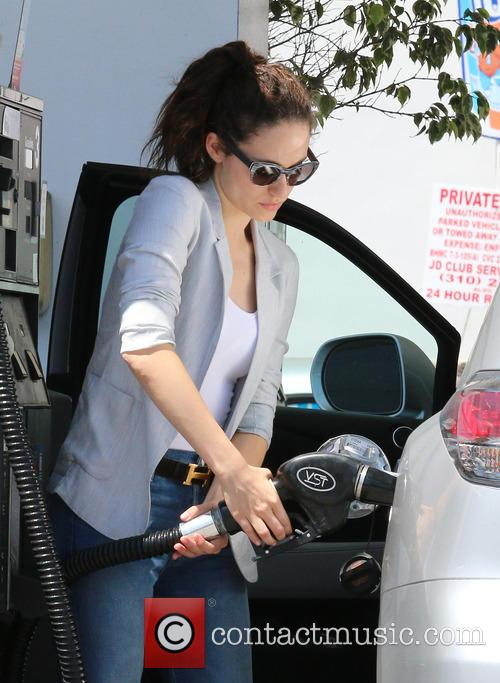 Emmy Rossum spotted pumping gas and running errands...