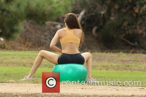 Alicia Arden exercising her yoga moves