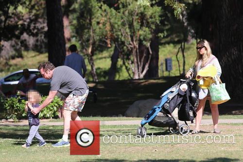 Tom Arnold and his family enjoy the day...