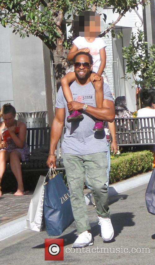 Jaleel White takes his family shopping at the...
