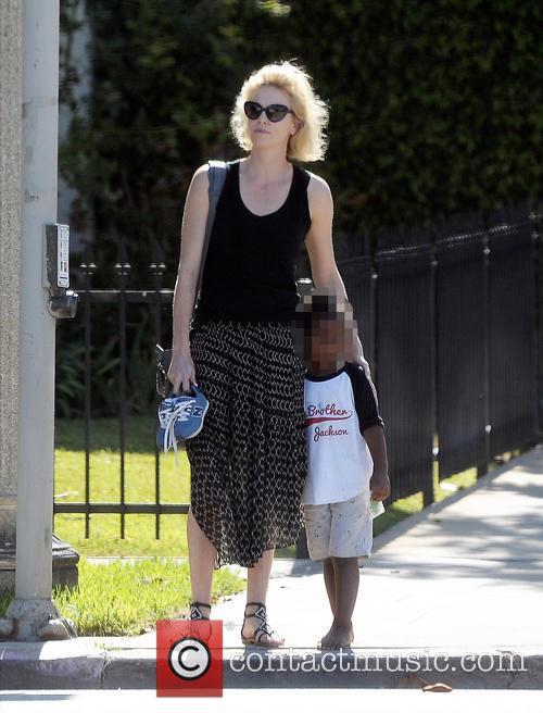 Charlize Theron out with barefooted son Jackson