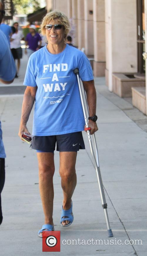Diana Nyadwearing a blue 'Find A Way' t-shirt