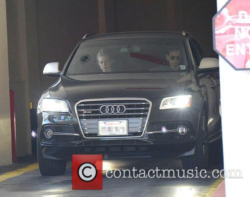 Elle Fanning spotted at the McDonald's drive-thru with...