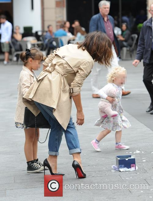 Myleene Klass leaving Global House with her daughter