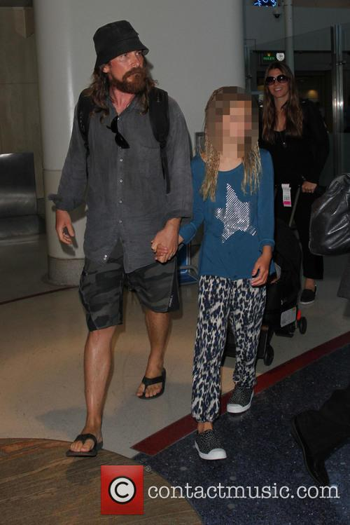 Christian Bale arrives at Los Angeles International Airport