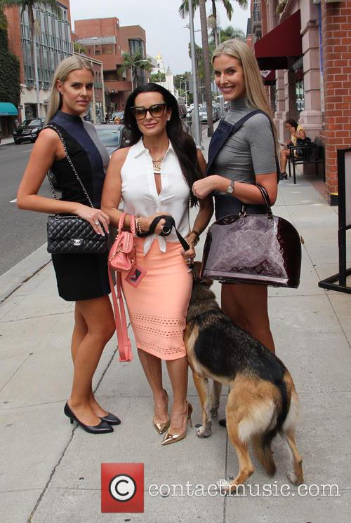 Monica & Camilla Berg out and about in...
