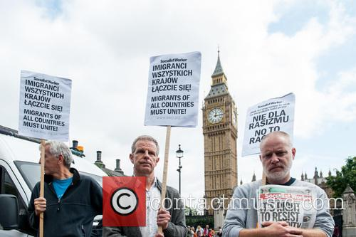 Polish migrants protest at the Houses of Parliament.