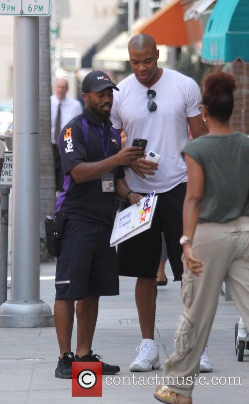 Basketball star Corey Maggette poses for photos with...