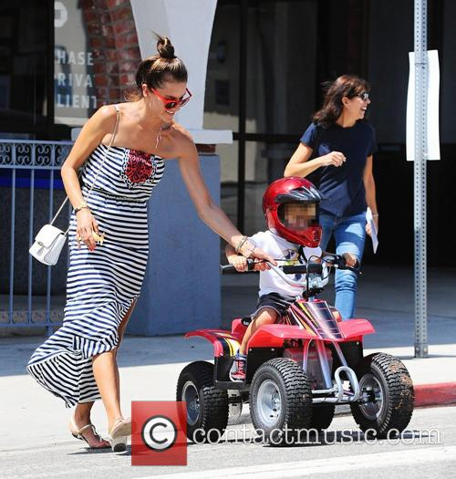 Alessandra Ambrosio helps her son Noah take a...