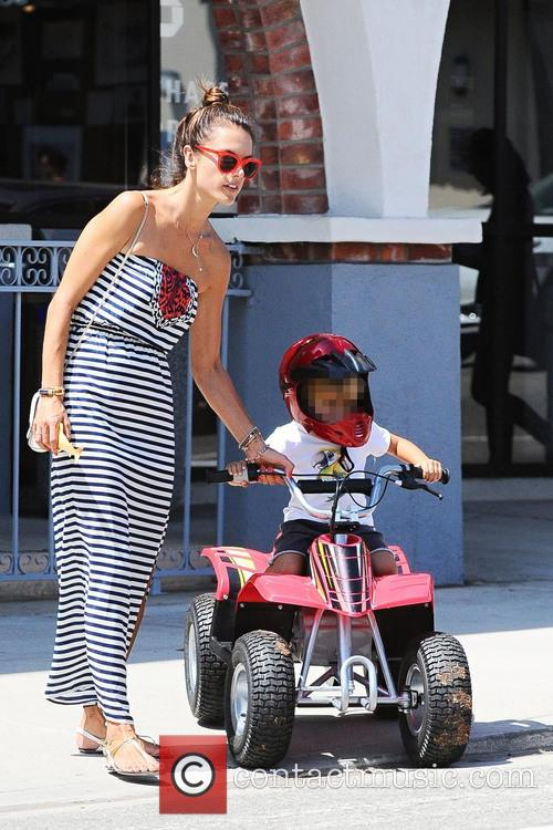 Alessandra Ambrosio taking her son for a ride