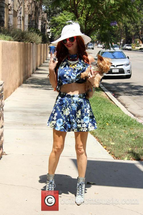 Phoebe Price walks her dog Henry on a...