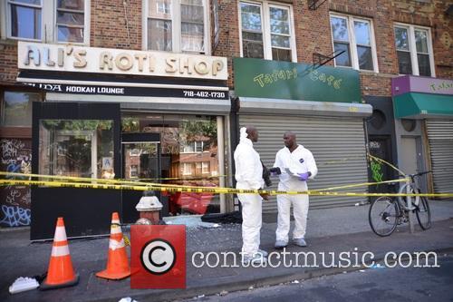 Exterior of Ali's Roti where 1 person was...