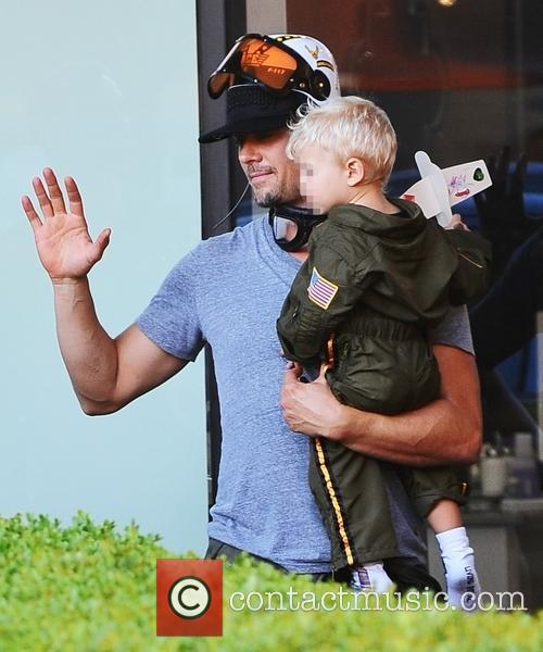 Fergie and Josh Duhamel out with their son...