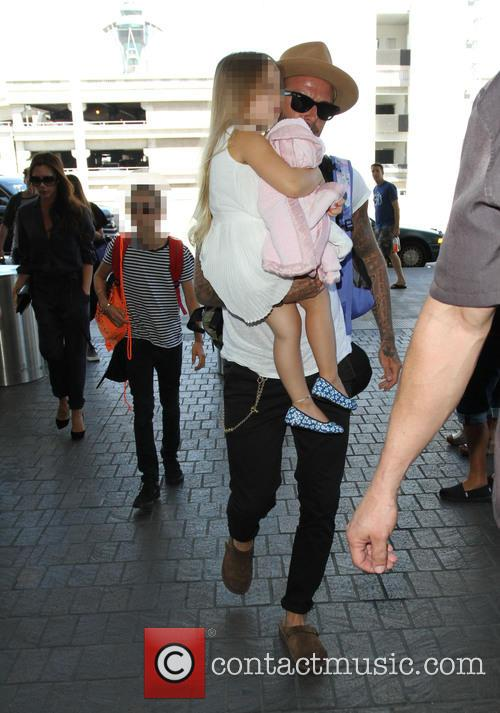 David Beckham and family at Los Angeles International...