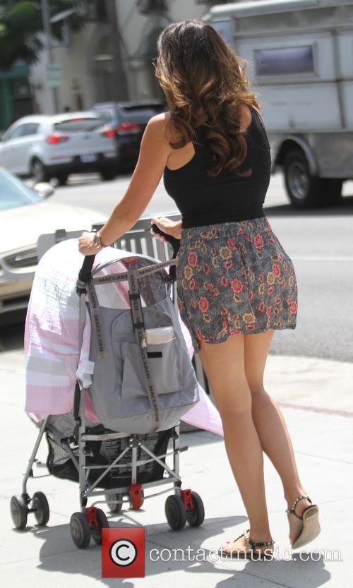 Tamara Ecclestone taking a stroll with her husband...