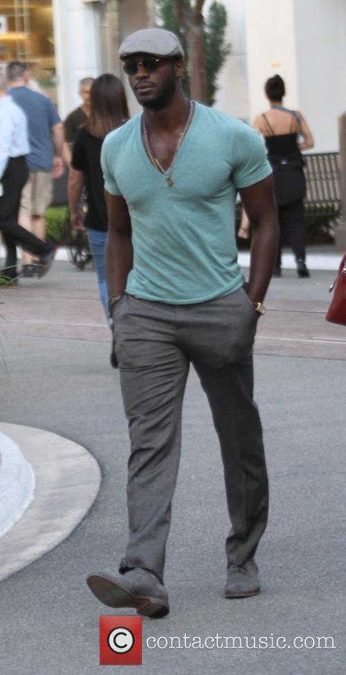 Aldis Hodge out shopping with his mother at...