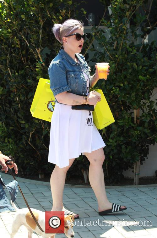 Kelly Osbourne goes shopping with a friend at...