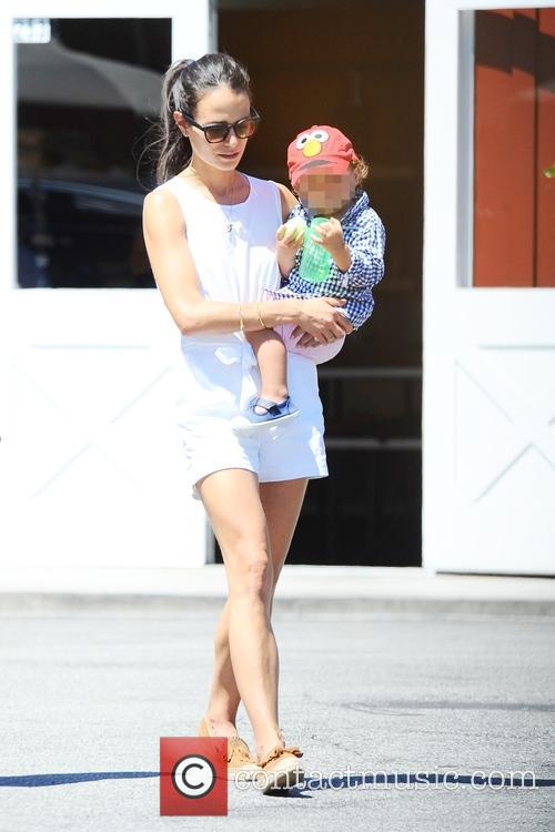 Jordana Brewster taking a walk with her son