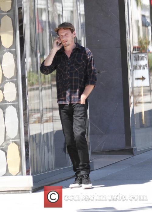 Anton Yelchin talks on his cellphone