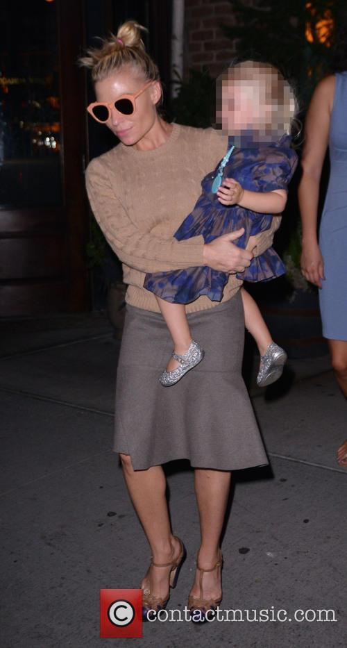 Tracy Anderson carries her daughter in TriBeCa