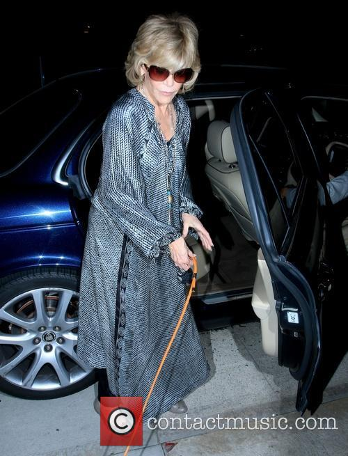 Jane Fonda getting out of the back of...