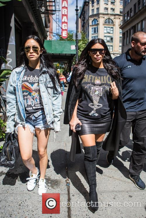 Kim Kardashian and a friend head out for...