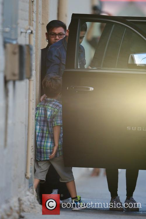Ricky Martin leaves ABC studios with his two...