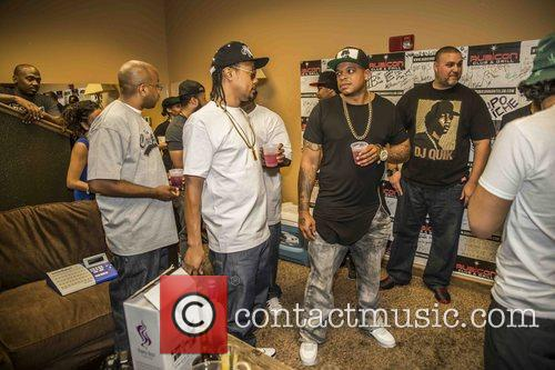 Curtis Young visits DJ Quik backstage before his...