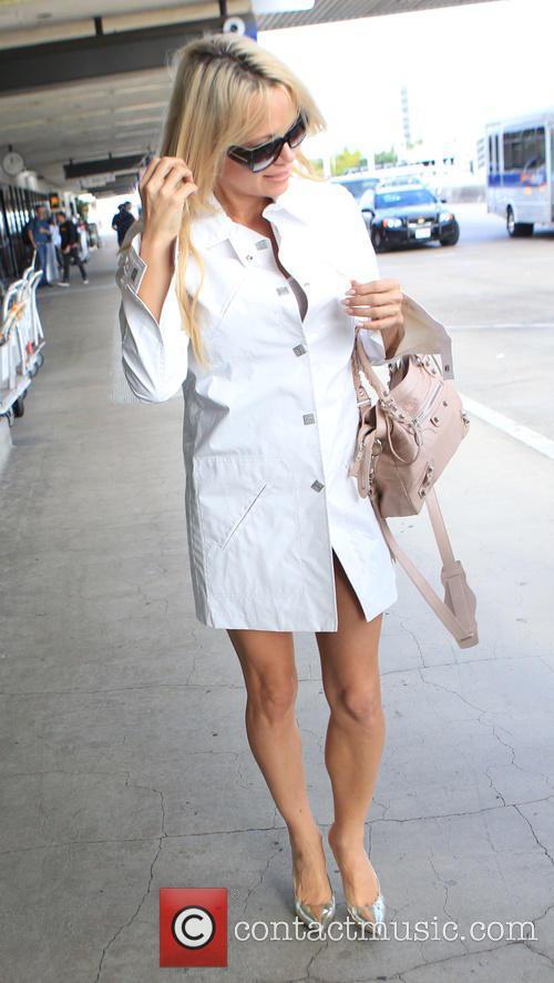 Pamela Anderson arrives at Los Angeles International Airport