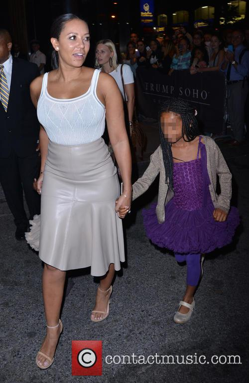 Mel B and her family outside Trump SoHo...
