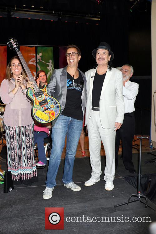 Carlos Santana donates instruments to Opportunity Village's Music...