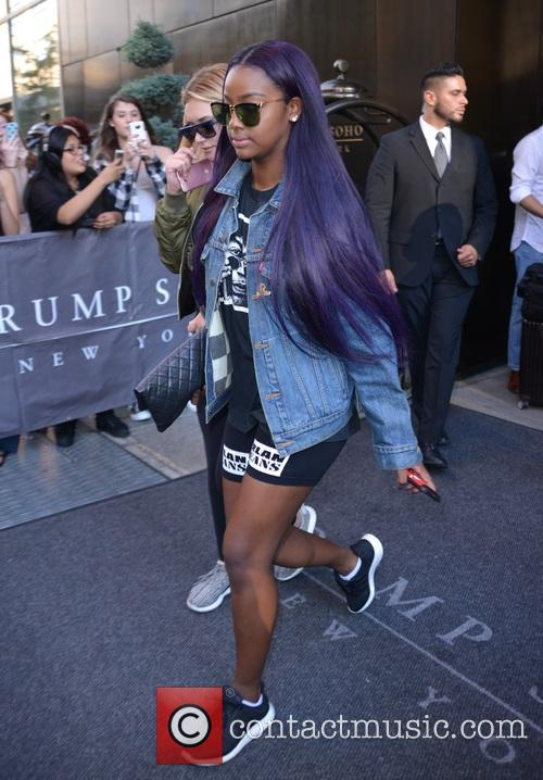 A purple haired Justine Skye leaving her hotel