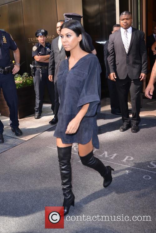 Khloe and Kourtney Kardashian Exiting their hotel...