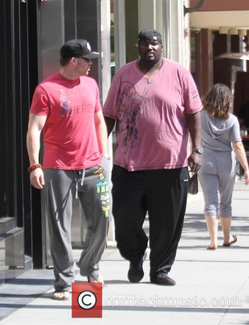 Quinton Aaron shopping in Beverly Hills