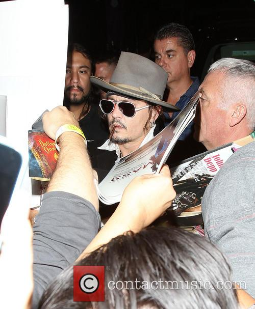 Johnny Depp greets fans outside the Roxy