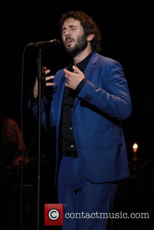 Josh Groban performing at the Tower Theatre