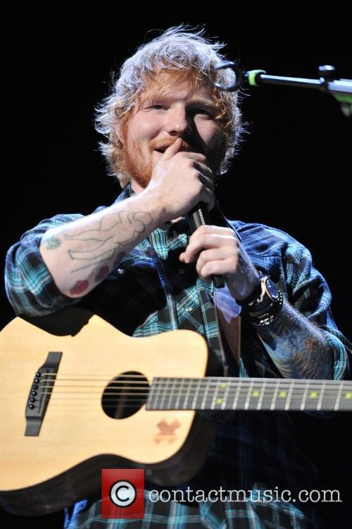 Ed Sheeran performing live in concert