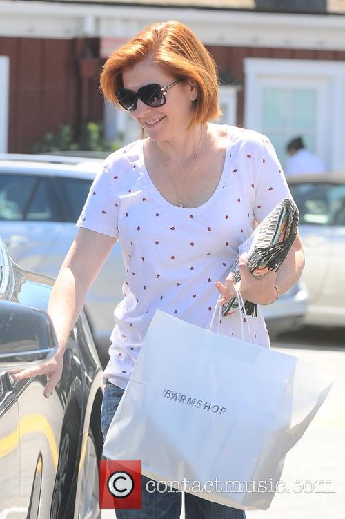 Alyson Hannigan shopping for groceries