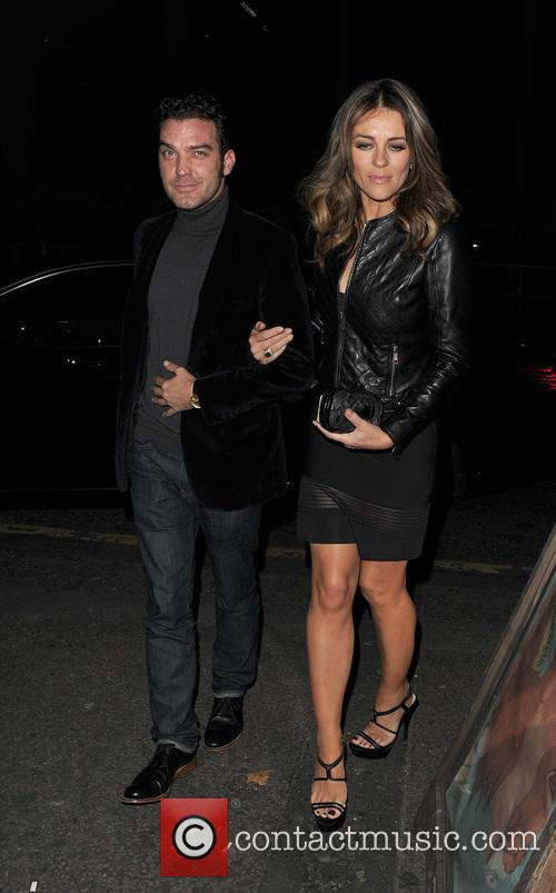 Elizabeth Hurley appears very close to her on...