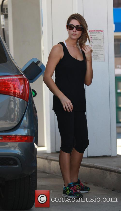 Ashley Greene pumping her SUV with gas
