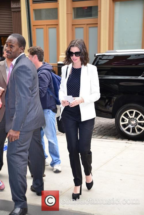 Anne Hathaway returning to her hotel in New...