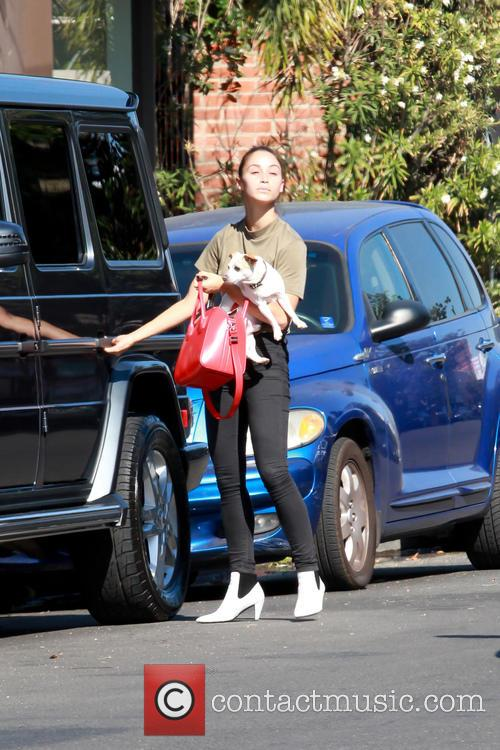 Cara Santana out and about with her dog
