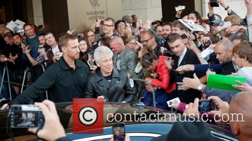 U2 band member Adam Clayton is seen greeting...
