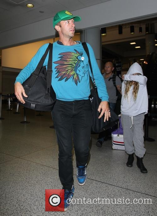 Chris Martin departs from Los Angeles International Airport