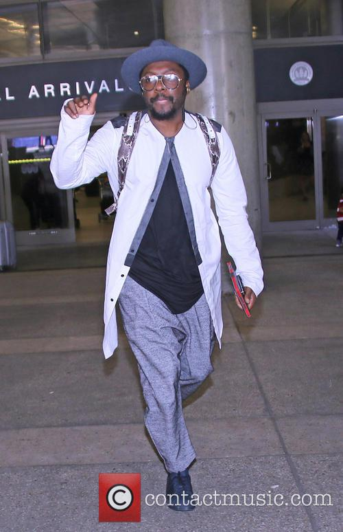 Will i Am arriving at Los Angeles International...